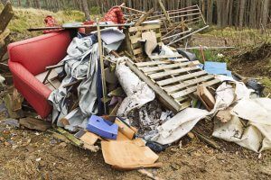 Fly tipping waste in woodlands