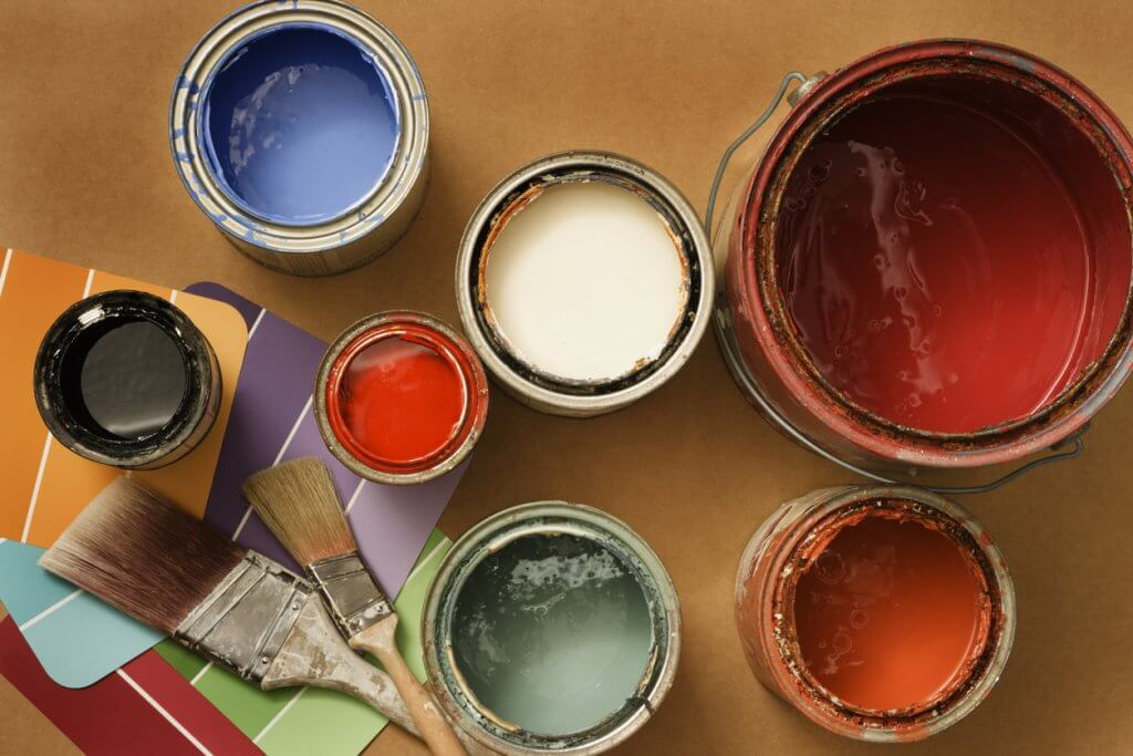 Used paint tins ready for disposing